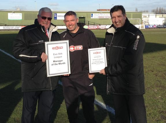 Lee Ashcroft, centre, receives his award for Manager of the Month.