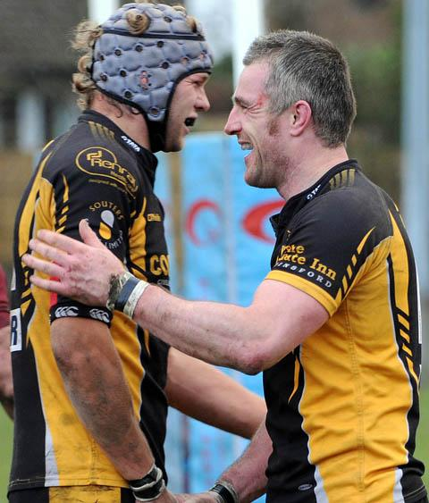 Steve Campbell, right, takes the acclaim of teammate Chris Heywood after his hat-trick of tries.