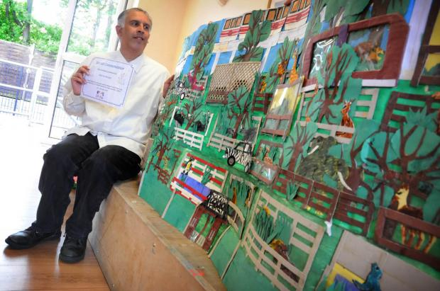 Minerva Hussain with his award-winning work.
