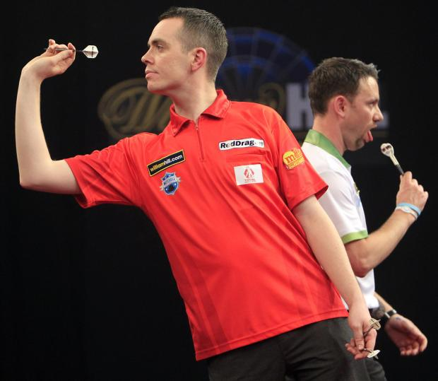 Stuart Kellett throws during his group stage encounter with Paul Nicholson at the William Hill Grand Slam in Wolverhampton last month. Picture: Lawrence Lustig/PDC