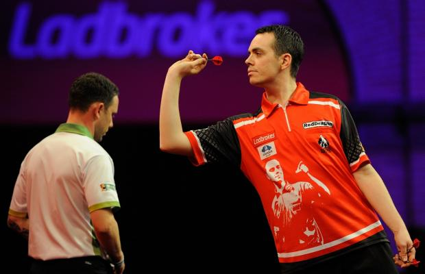 Stuart Kellett, from Northwich, throws during his Ladbrokes World Championship match against Paul Nicholson on S