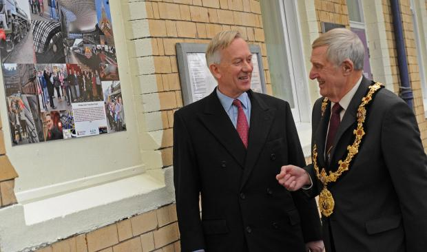 David Briggs, Lord Lieutenant of Cheshire, discusses the photo plaque with Clr Bob Robinson, mayor of Northwich.