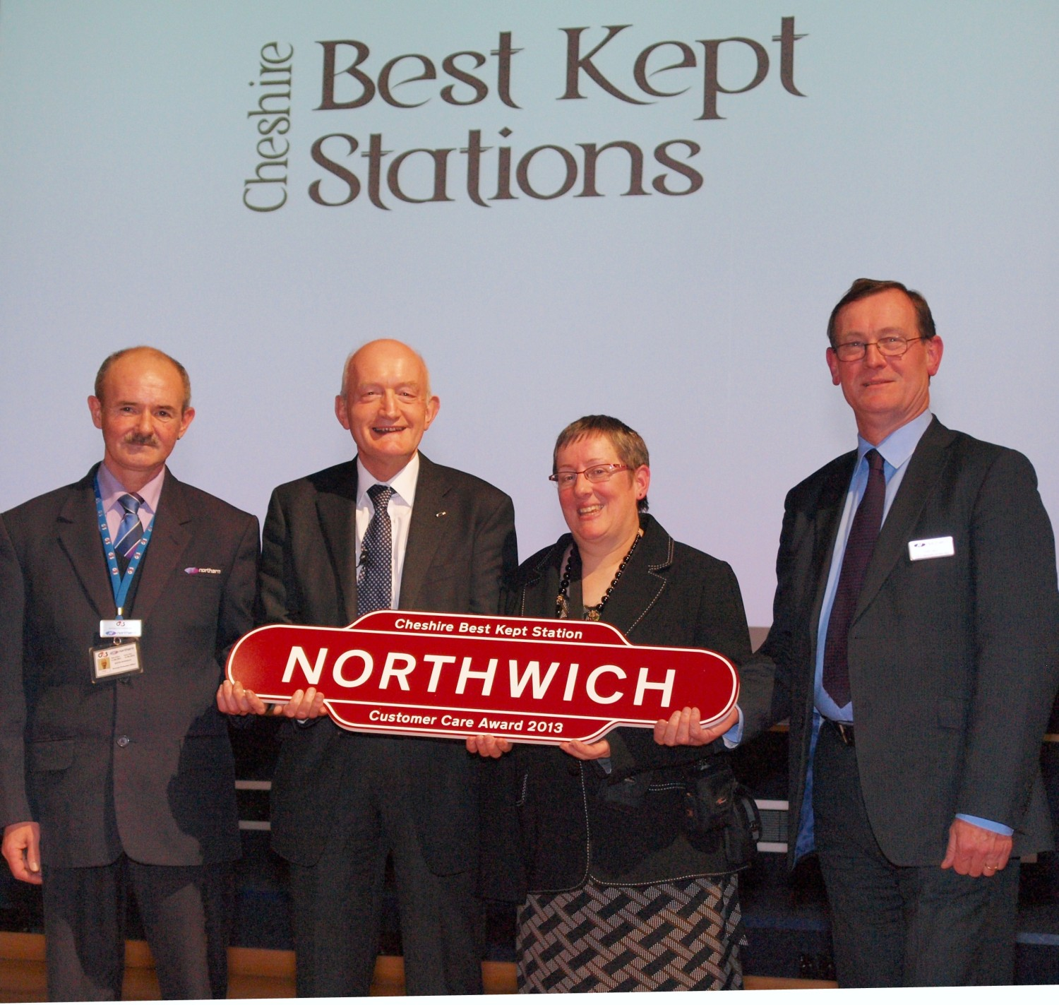 Kevin Howman, from Northern Rail, Mark Barker, formerly from Northern Rail, Sally Buttifant, community rail officer for the Mid Cheshire Line, and Don Jary, from Northern Rail, celebrate Northwich's success.