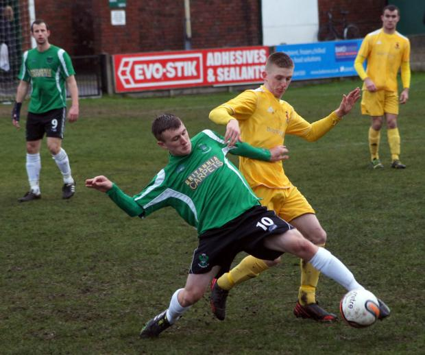 1874 Northwich front man Matthew Ward battles for possession during Saturday's last eight. Picture: Annie Hilditch