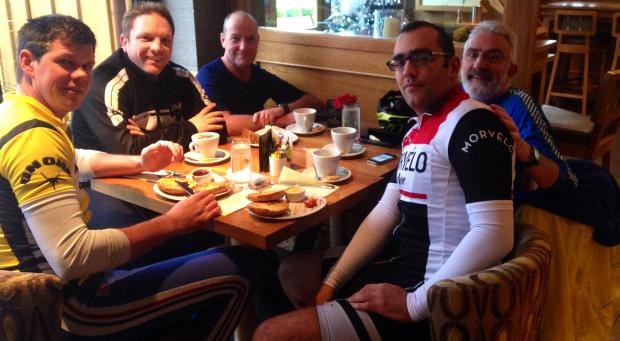 Vélo Club Grange cyclists enjoy an obligatory cafe stop on their last outing. Pictured, from left, are Matt Jump, Simon Howells, Derek Heine, Alex Masters and Howard Kelly.