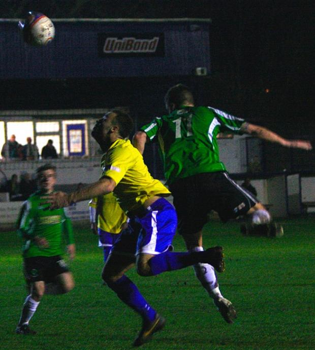 Northwich Guardian: Ryan Stewart heads for goal during 1874 Northwich's win on Tuesday night. Picture: MATT DRAYCOTT