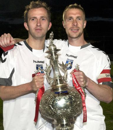 Lee Duckworth, left, and Lee Jones with the League Challenge Cup following Winsford United's victory in 2011. Picture: ALBERT COOPER
