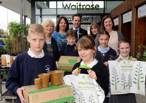 Logan Crowley and Isabelle Fenton, both nine and from Comberbach Primary School, pick up the Grow and Sell kits with Victoria Road Primary School pupils Kyle Coles, nine, Libby Hulse, eight, and Paige Keen, eight.