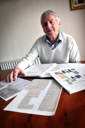 Malcolm Rutter with documents that reveal his grandfather's bravery during the First World War