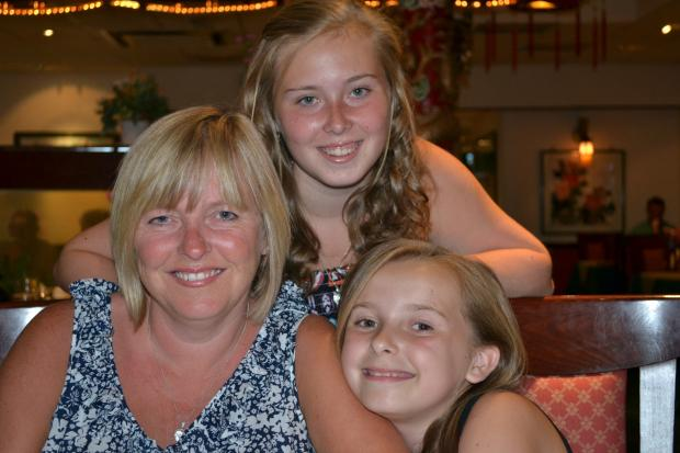 Claire Garton with her daughters Lauren and Ellie