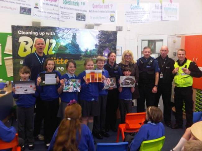 Year Six Moulton Primary School pupils, Paul Davis, from the council's Streetscene service, PCSOs Kat Stock and Steve Bishop, Clr Helen Weltman, and community safety wardens Alan Melbourne and Pete Harding.
