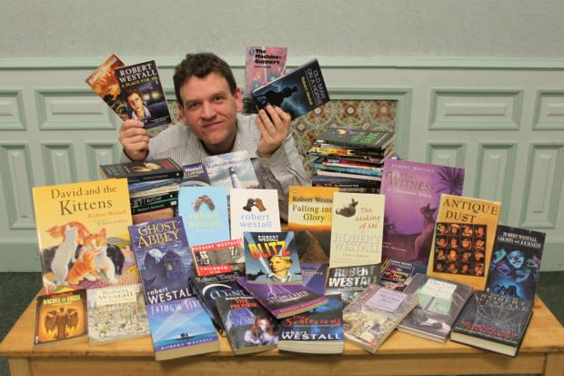 Tom Hughes, from Weaver Hall Museum, with all of Robert Westall's books.
