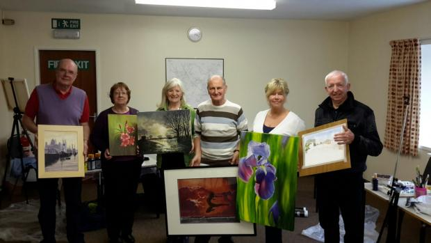Graham Watson, Janet Poole, Bernice Tackley, Tony O'Neill, Jane Caldwell and Peter Twist get ready for the exhibitio
