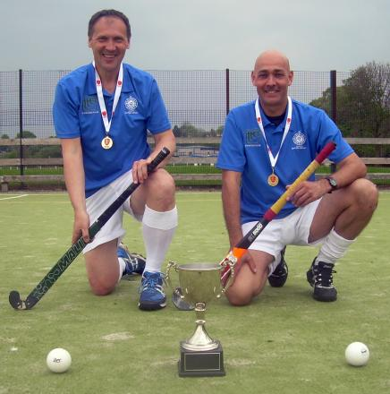 Winnington Park Hockey Club's John Stackhouse, left, and Robin Bowden show off the silverware they won as part of the North's successful men's over 50s team.