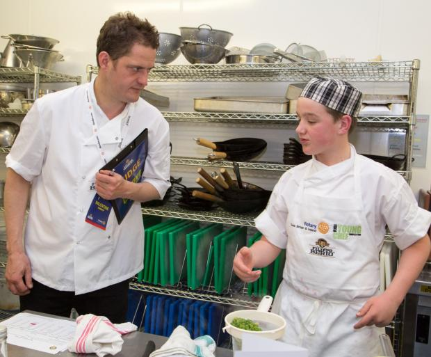 Mathew Thomas is put through his paces by an adjudicator at the national final of the Rotary Youg Chef competition.