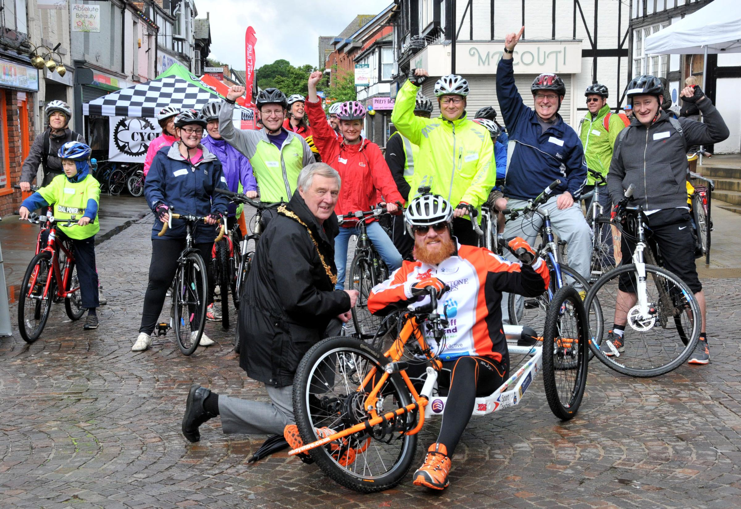 Northwich Guardian: Northwich's mayor Clr Bob Robinson and hand-cyclist Adrian Derbyshire, hate crime ambassador, with riders in the Festival Village.