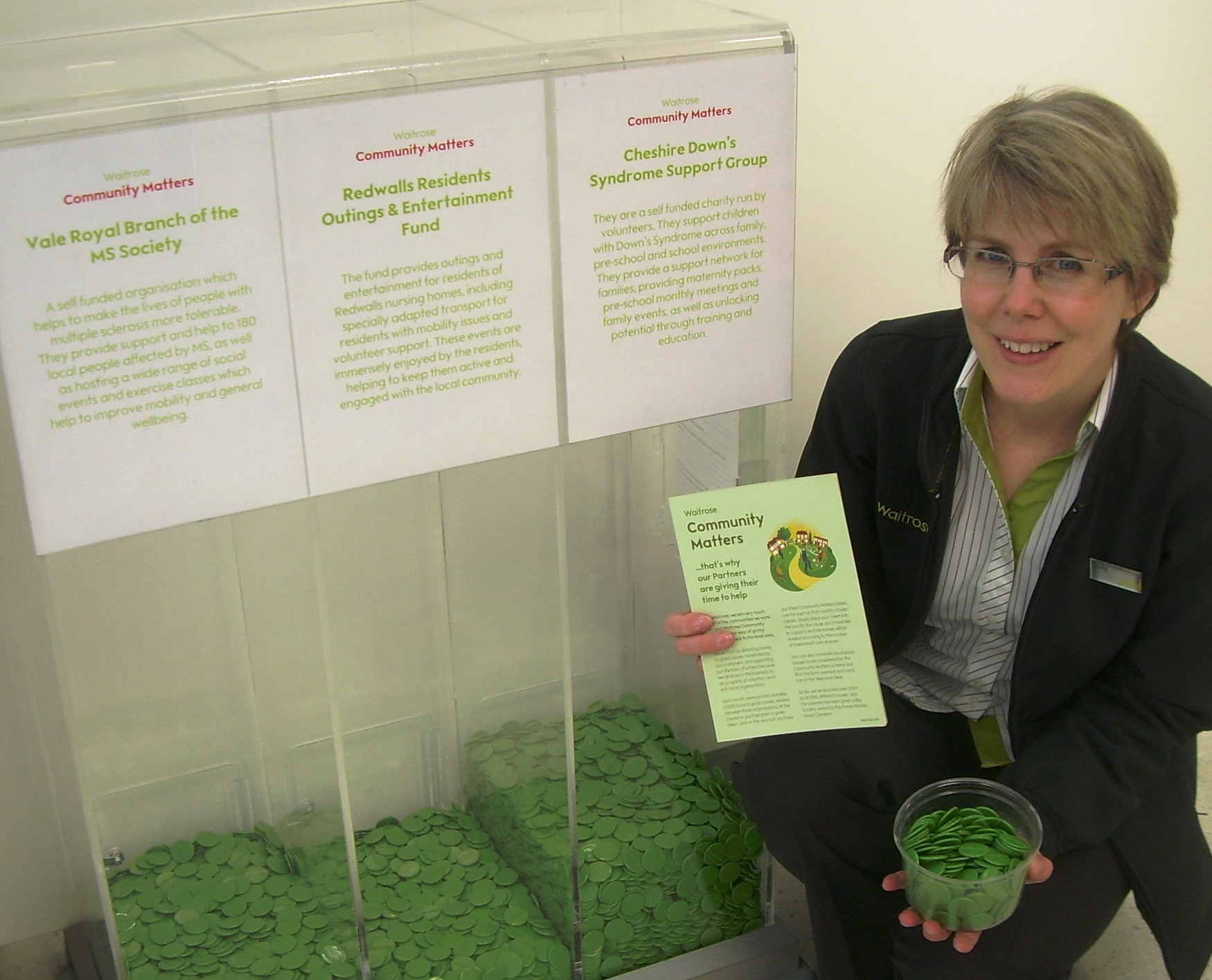 Assistant section manager Sally Mortimer next to the Community Matters donation boxes at Waitrose in Northwich.