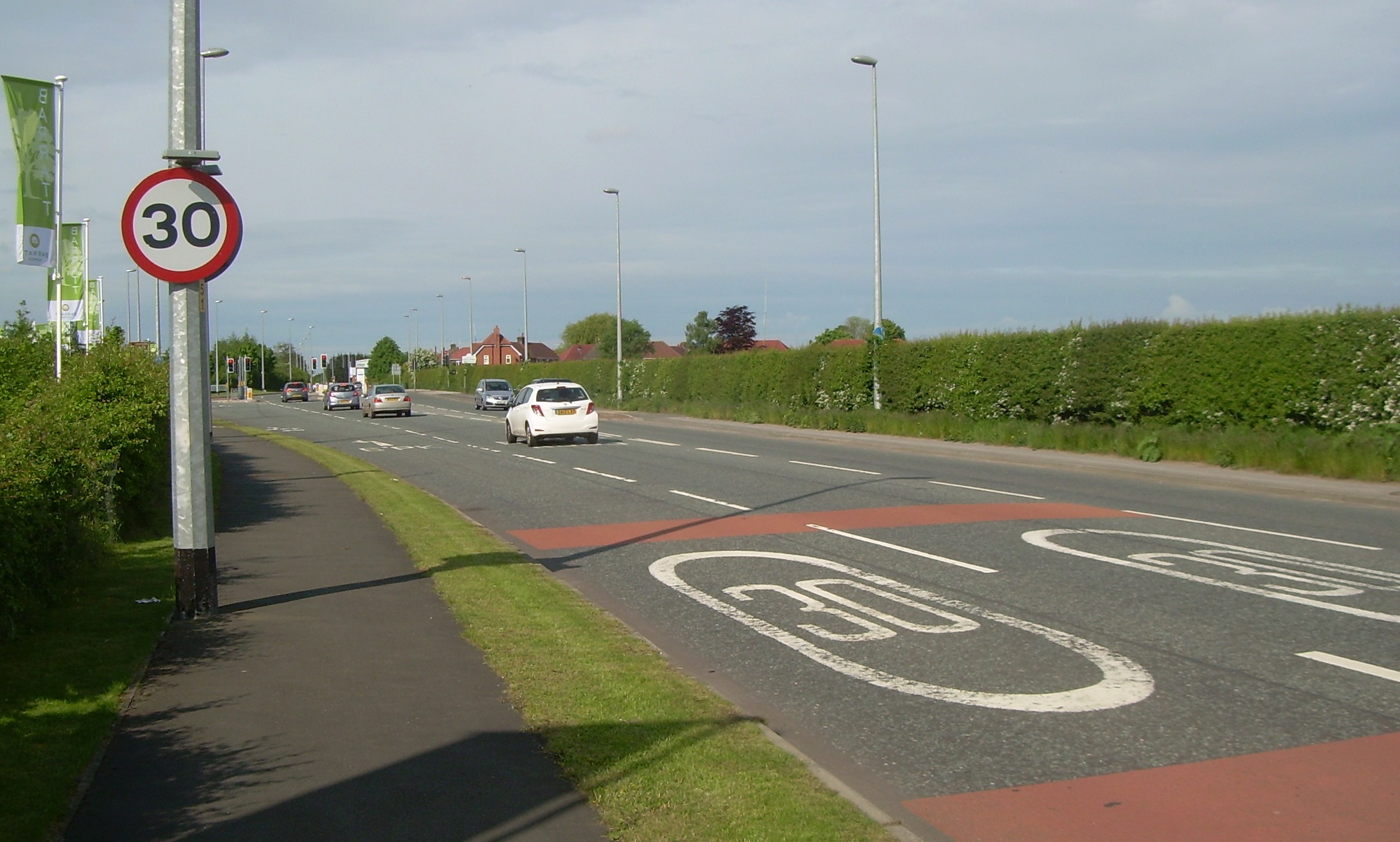 The 30 limit features on a sign and the road as motorists leave the A556.