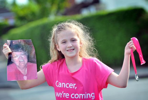 Yasmin Karkin with a picture of Mrs Curzon and her Race for Life medal