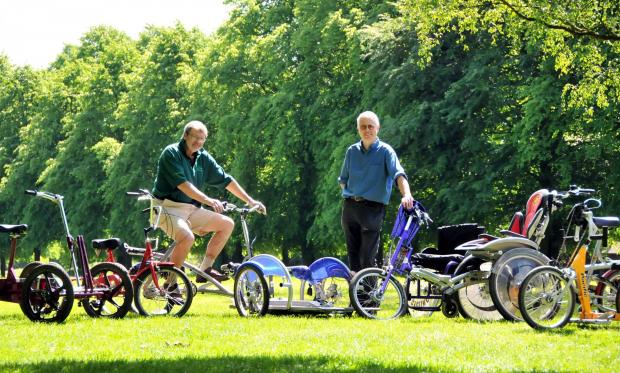 Pete Wilding, from Wheels for All, and Chris Mosely, ranger at Marbury Park, show off the fleet of cycles.