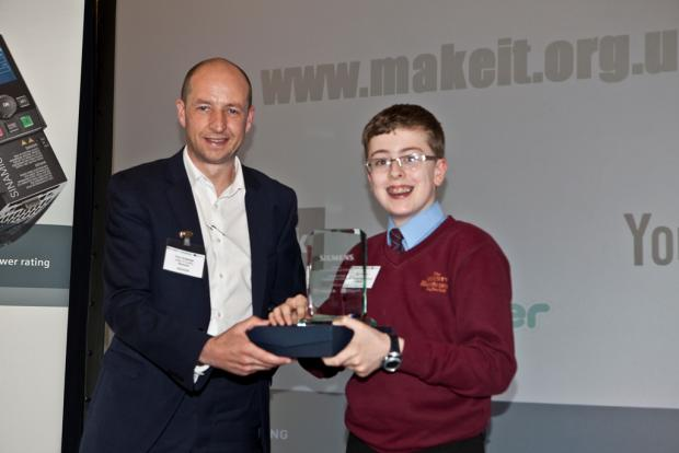 Northwich Guardian: Sam Flowers receives his award from Paul Grattidge, head of quality at Siemens