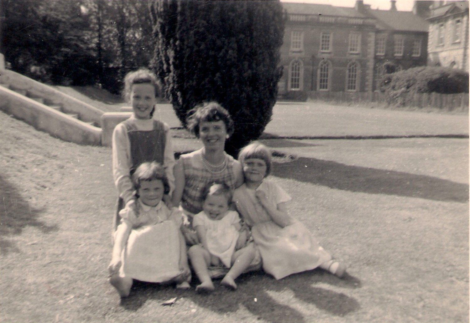 The Campbell family on the steps to the open air pool with Marbury Hall in the background. This picture was taken in 1960.