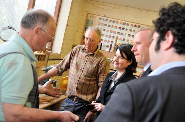 Public health minister Jane Ellison finds out about the Men in Sheds project.
