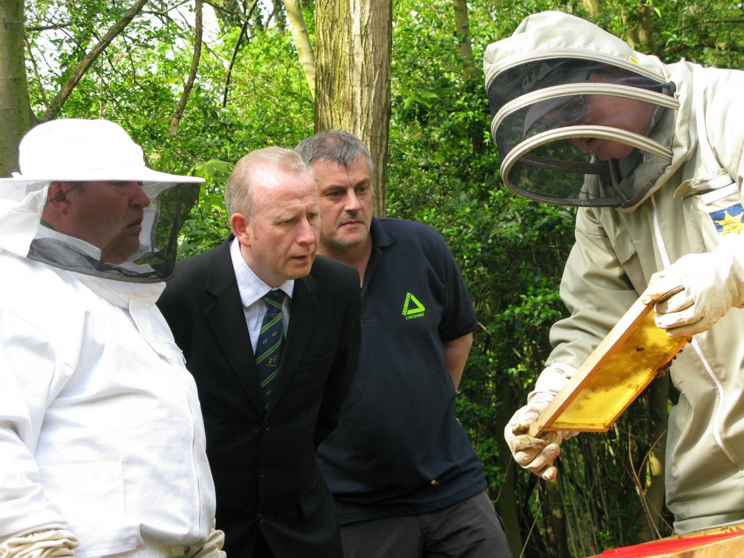 Graham Evans MP and Andy Martin, Grozone project manager, find out more about the beehives.