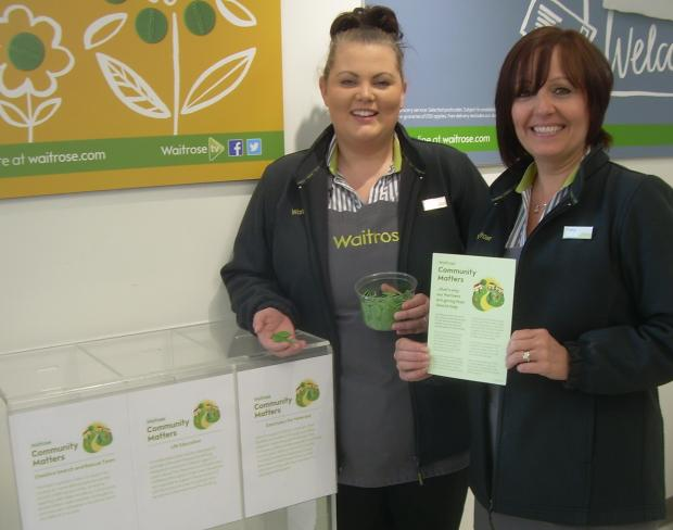 Waitrose staff Zoe Hill, left, and Tracy Bennett promote the Community Matters scheme.