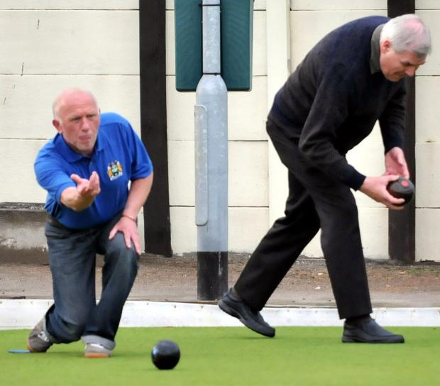 Alan Vickers, left, bowls during his qualifying round encounter with Crowton's Peter Bellis at Rudheath Social Club on Monday. Picture: NICK JONES