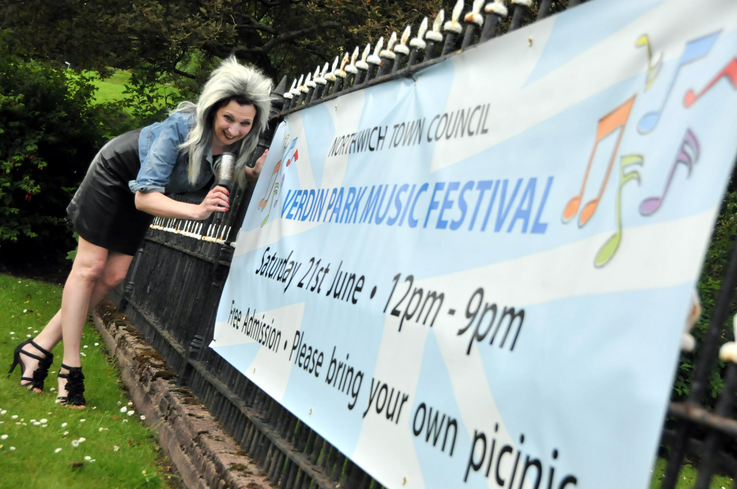 Town mayor Clr Alison Gerrard dons a Tina Turner wig and sings into her hairbrush as she gets ready for the Verdin Park Music Festival on Saturday.