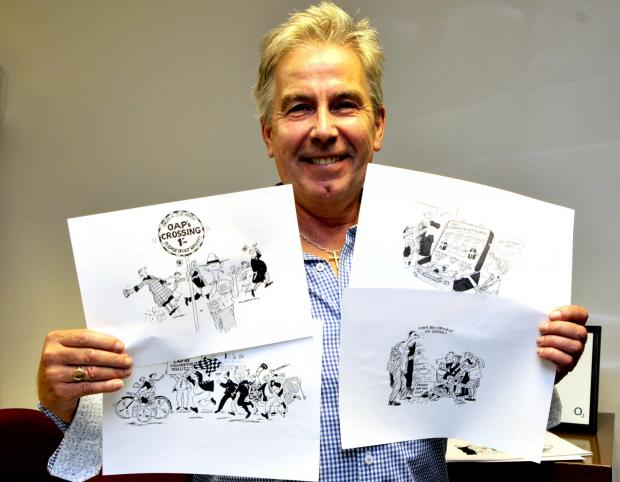 Northwich Guardian: David Yearsley with some of the illustrations for his book, which were drawn by Bill Tidy.