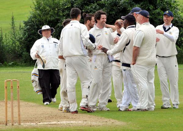 Weaverham newcomer Russ Walker, centre, takes the acclaim of his teammates after taking a wicket against Northwich. Picture: NICK JONES