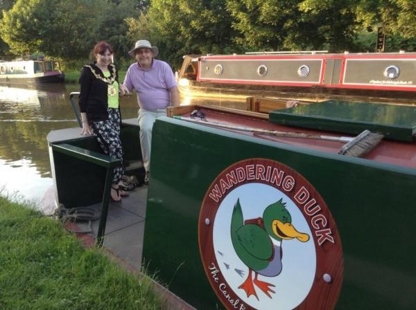 Clr Alison Gerrard, Northwich town mayor, and Clr Paul Edwards, Middlewich town mayor, take the tiller on the Wandering Duck.