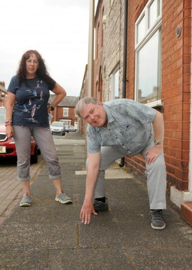 Northwich Guardian: John Evans and Jan Godfrey say their flagged footpath is fine as it is.