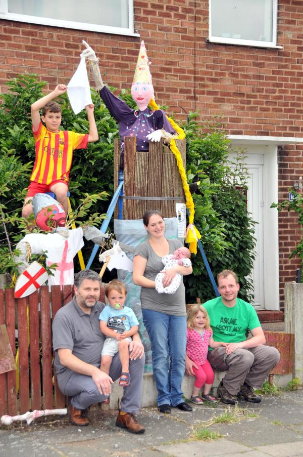 The two families show off their scarecrows. Pictured, from left, are Dylan Darlington, nine, Adam Darlington, Jacob Darlington, two, Laura Forshaw and baby Eli, Piper Forshaw and Gavin Forshaw.