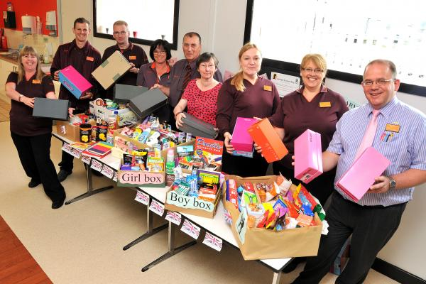 Sainsbury's staff present the goodie boxes to Jim and Tina Cagna, centre.