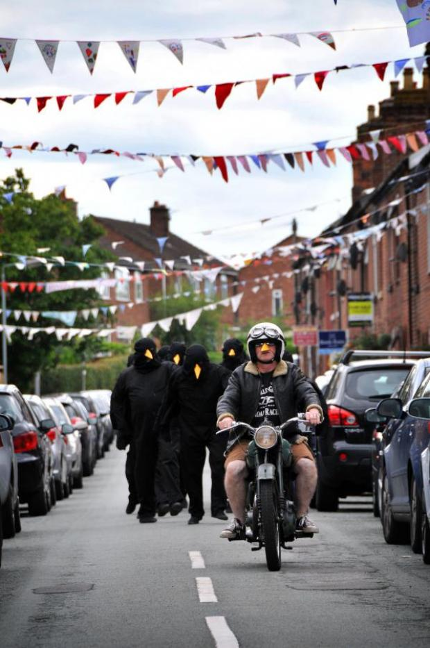 Northwich Guardian: The crows are led along Regent Street by a vintage motorcycle.