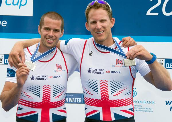 James Foad, left, and Matthew Langridge show off the silver medals they won in the men's pair at the season's final World Cup regatta. Picture: Peter Spurrier/GB Row