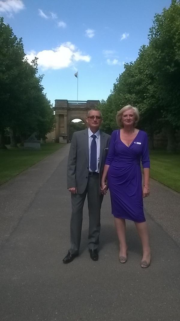 David and Louise Parry in front of the Royal Standard at Chatsworth, flying to show that the Queen was there.