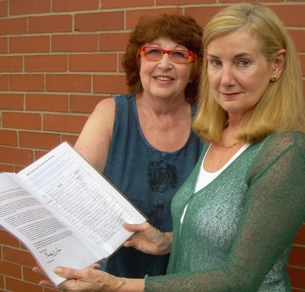 Pamela Lavers, right, presents the petition to Wincham Parish Council chairman Annie Makep