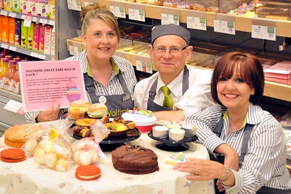 Customer services supervisors Zoe Cadman and Tracy Bennett and Waitrose baker David Dean promote the Great Bake Sale