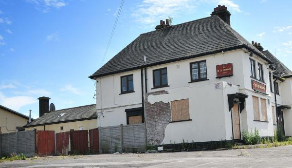 The boarded-up Black Greyhound pub