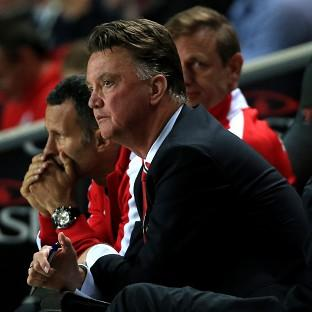 Louis van Gaal watches on as his side are thumped by MK Dons