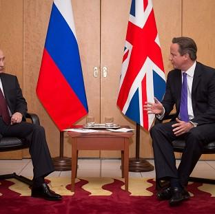 David Cameron (right) said Vladimir Putin's claims were