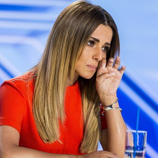 Cheryl Fernandez-Versini cries during contestant Amy Connelly's audition on The X Factor
