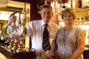 Robert and Anita celebrate 300 years of Comberbach pub
