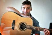 Chris Tavener hopes his guitar will help him triumph at Open Mic UK 2014.