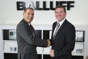 Gary Spearing, left, is congratulated by managing director John Radford