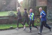 Club members enjoy a Sunday morning run